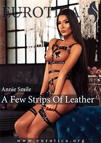 Annie Smile wears nothing but a few strips of leather in her newest photo set.