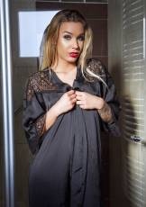 Petite Jenny is waiting for her fans in a silky black robe to show off her beautiful, natural body.