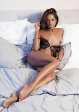 Nirmala is an all-natural seductress with warm brown eyes and impeccable figure, who wears a lacy nightgown, but not for long.