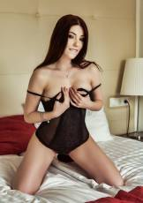 Mia Evans is a cute girl with raven hair, white skin and small boobs who loves to show off her perfect slender body.