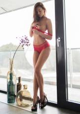Sabrisse looks amazing while posing for the camera in a sexy red lingerie and even without it.