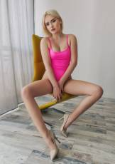 All-natural Nicole shows off her irresistible, petite figure in a sexy pink bodysuit.