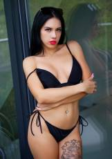 Daniella enjoys the pleasant outdoor breeze while seductively removing her bikini.