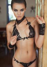 Ella is a beautiful brunette with entrancing brown eyes and perky natural tits.